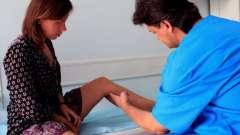 Чому виникають червоні плями на ногах?